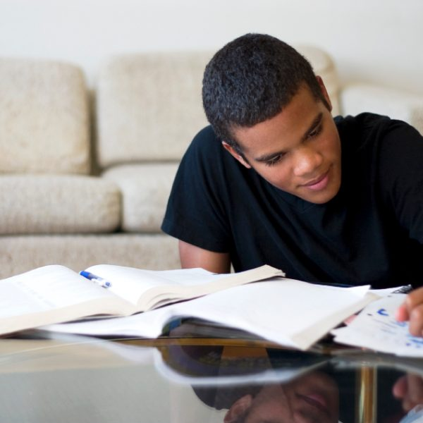16 year old boy working on his homework.